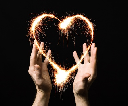new love: fiery heart of a person Stock Photo