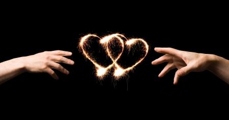 Fiery hart en handen van de liefde.