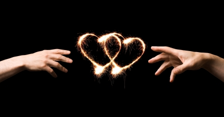 love symbol: Fiery heart and hands of love.