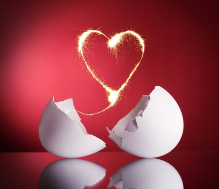 Sparkling heart of the broken eggs hatched. Symbol valentines. photo