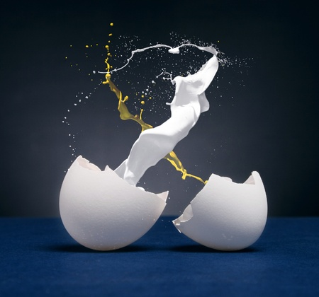 yolk: Splash and yolk protein from the broken eggs. Stock Photo