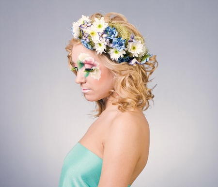 Beautiful young woman with delicate flowers in their hair photo