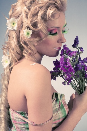 Beautiful young woman with flower Stock Photo - 12964921