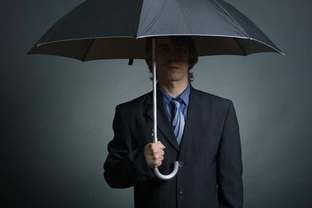 secret agent: Businessman with Umbrella Stock Photo