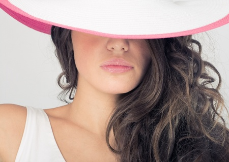 fashion photos: Fashion photos delightful woman in a white hat, close-up. Stock Photo