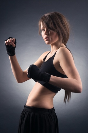 combative: Young woman in sports.