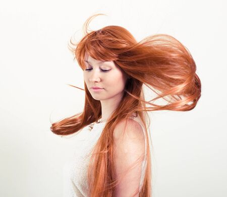 beautiful woman with magnificent red hair photo