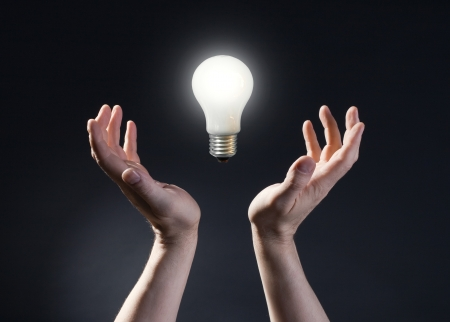 magic lamp: Hand holding light bulb