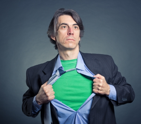alter ego: Superhero, young businessman tearing his shirt Stock Photo
