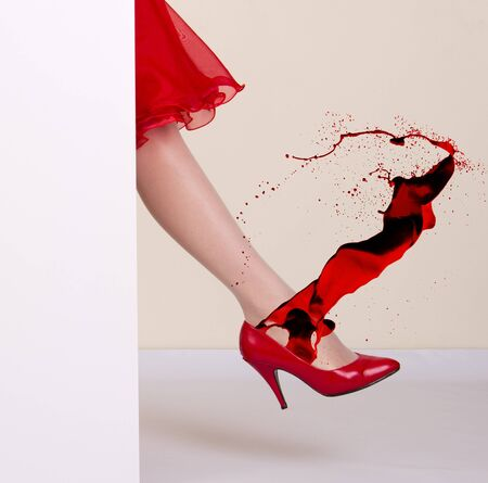 red shoes: Elegant woman leg in red shoe.