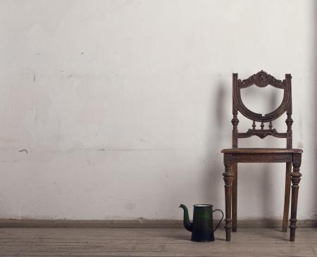 Retro chair and tea in the interior. Banco de Imagens