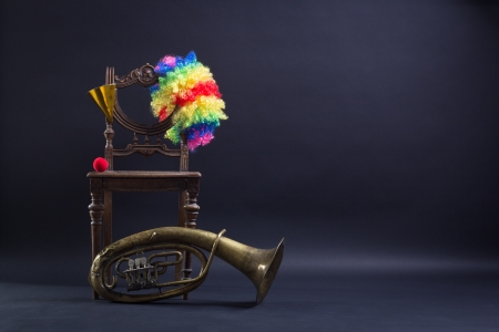 Clothing clown and trombone on a retro chair. photo