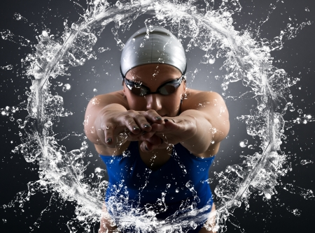 swimmer jumps into the water. Stock Photo