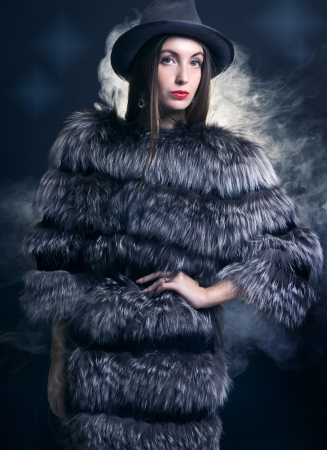woman in a fur coat and hat  photo