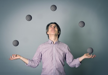 A man juggling several balls