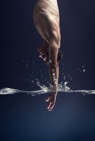 swimmer jumps into the water