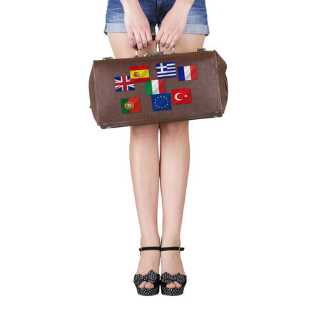 Feet girl with a suitcase in hand  photo