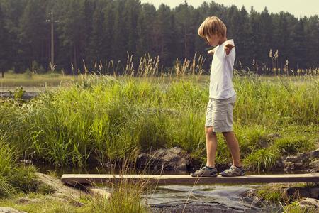 Boy on a wooden bridge