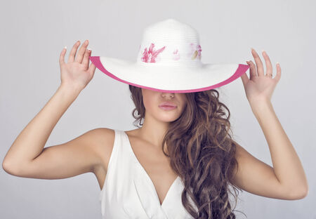 Luxury young woman in a white hat  photo
