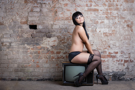 Young sexy woman with retro TV photo