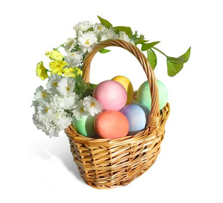 Easter basket with colored eggs and flowers wrapping around the basket handle. Isolated on white.