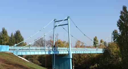 The cable-stayed bridge across the Tsna Russia.Tambov river. Autumn day.