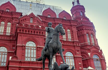 Moscow, Russia. April 14, 2019 Monument to commander Georgy Zhukov against the background of the historical museum. Редакционное