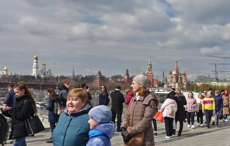 Moscow, Russia. April 14, 2019 People on the floating bridge in Zaryadye Park admire the panorama of Moscow
