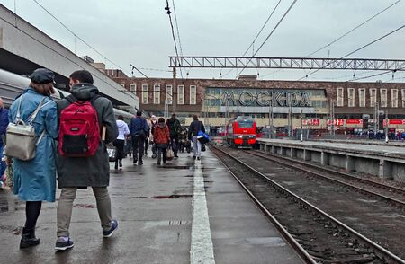 Moscow, Russia. April 9, 2019 Paveletsky railway station in Moscow, Russia. Passengers going from the train to the exit. Text translation: Moscow