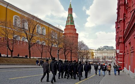 Moscow, Russia. April 14, 2019. A group of cadets walking along the Kremlin wall in Moscow in spring