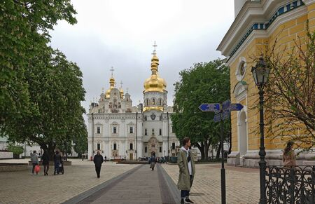 Kyiv. Ukraine. may 11, 2019 View of the Assumption Cathedral in Kiev Pechersk Lavra in the spring. People in the territory of the laurels. Chestnut blossoms
