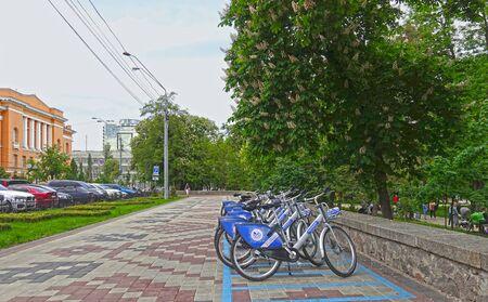 Kiev. Ukraine. May 16, 2019 Kiev. Ukraine. May 16, 2019 Bicycles rental standing in the park Shevchenko in Kiev