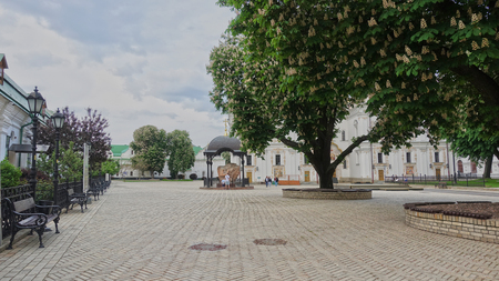 Flowering chestnuts on Uspenskaya square in Kiev-Pechersk Lavra in spring