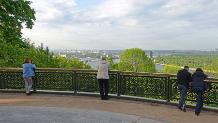 People on a spring day admire the view of Kiev and the Dnieper on the observation platform of the Vladimir Hill Stok Fotoğraf