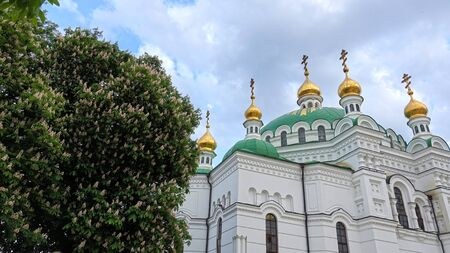 Refectory temple of Kiev-Pechersk Lavra in spring, flowering chestnut Фото со стока