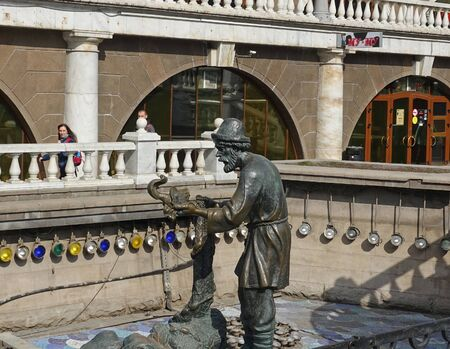 Moscow, Russia. April 7 2019 Sculpture of a fairy tale character from the Russian fairy tale About the Fisherman and the Fish , Manezhnaya Square, shopping complex Okhotny Ryad