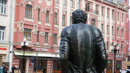 Moscow, Russia. April 7 2019 Monument to the poet Bulat Okudzhava on the background of the Arbat. Sculptor E. G. Frangulyan, was opened in 2002.