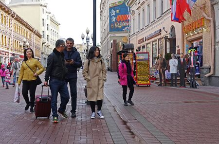 Moscow, Russia. April 7 2019 A group of tourists walking on the Arbat in Moscow happily shares their impressions
