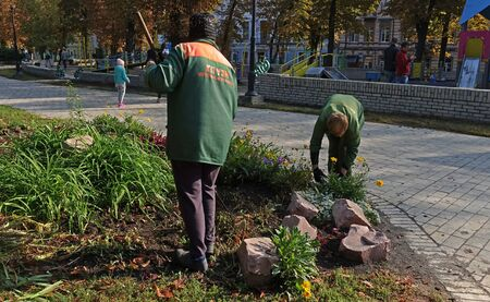 Kiev. Ukraine. October 01, 2019 Workers carry out landscaping and landscaping in the Shevchenko park in Kiev