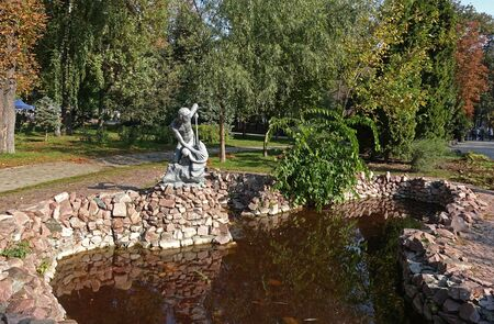 Kiev. Ukraine. October 01, 2019 The ancient Black Sea fountain in Shevchenko park in autumn in Kiev. Sculpture of a boy fisherman who caught a fish above the water