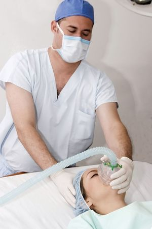 Anesthetist giving an anaesthetic to a patient  photo