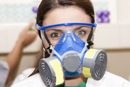 biological: Scientists with gas mask  working at the laboratory