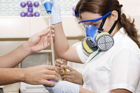 doctor with mask: Scientists with gas mask  working at the laboratory