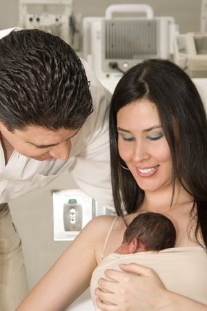 Family portrait, mom, dad and newborn baby enjoying together indoor photo