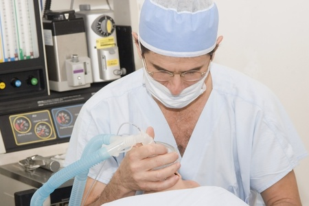 anaesthetic: Anesthetist giving an anaesthetic to a patient