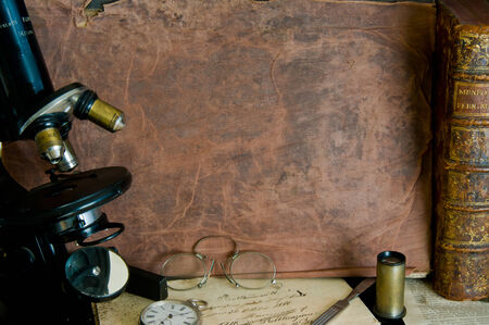 Background with microscope, pince nez, a silver watch and old books