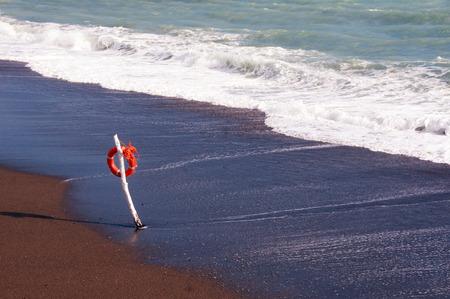 lifesaver on a pole on the beach