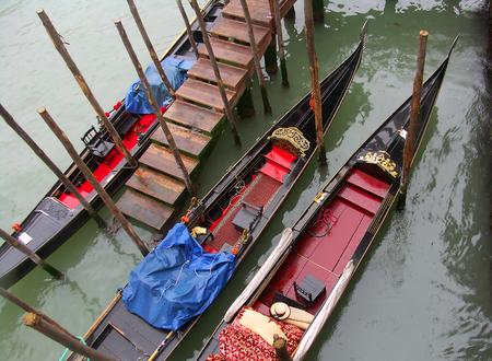 Gondole in Venezia under the rain