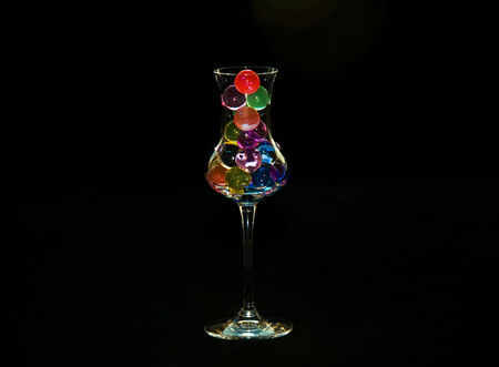 Glass with coloured water hydrogel beads