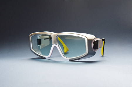 Protective safety glasses for laser medical treatment